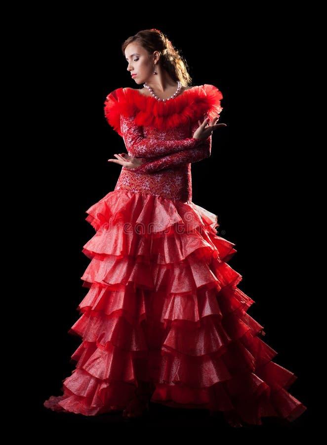 Neigungsfrauen-Flamencotänzer im roten Kostüm stockfotos