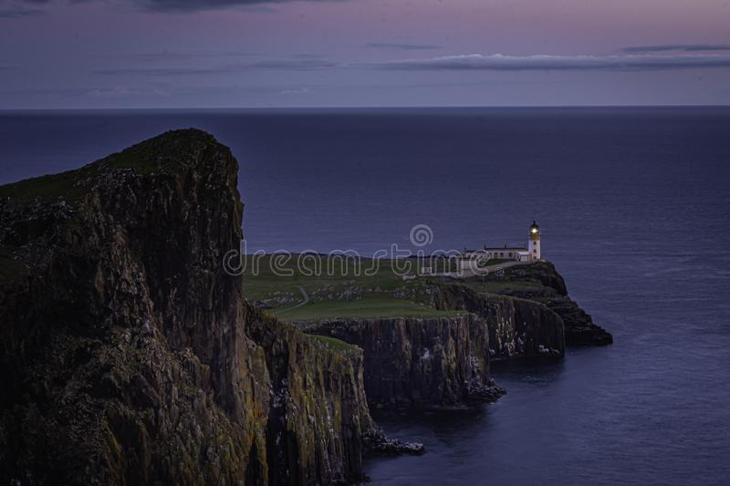 Neist Point, famous landmark with lighthouse on Isle of Skye, Scotland at blue hour stock images