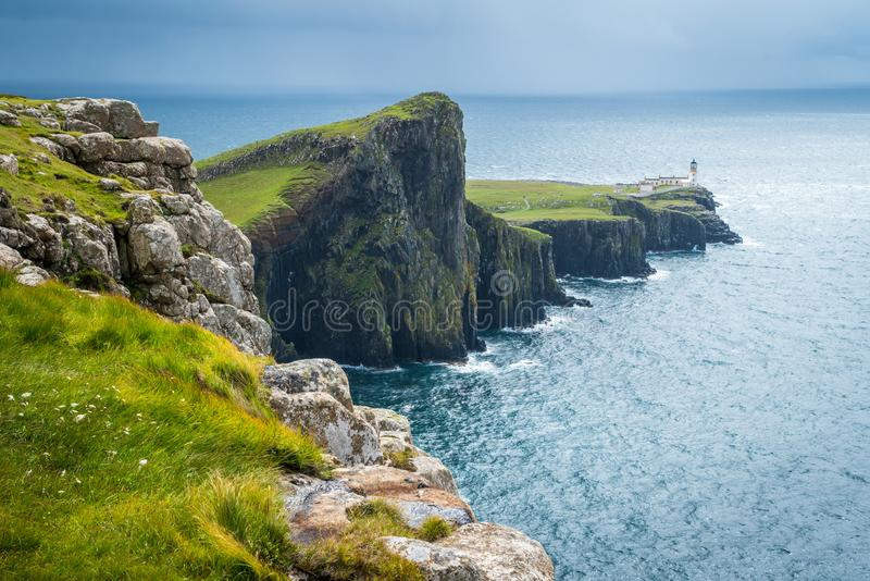 Scenic sight of Neist Point Lighthouse and cliffs in the Isle of Skye, Scotland. Neist Point is a viewpoint on the most westerly point of Skye. Neist Point royalty free stock images