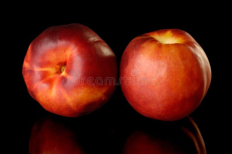 nektarinpersikared två royaltyfri foto