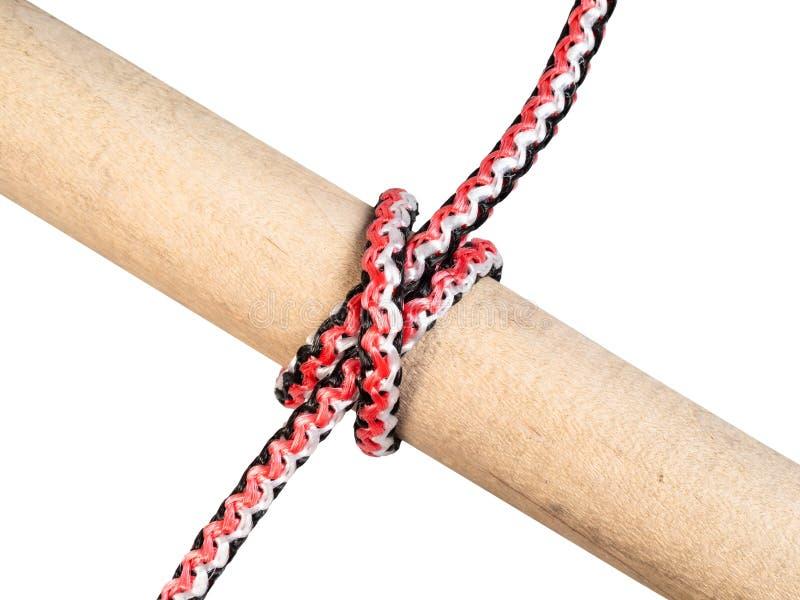 Nelkenproblemknoten gebunden auf dem synthetischen Seil herausgeschnitten stockbilder