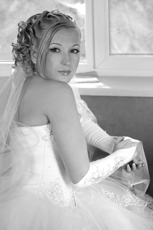 Nell'aspettativa dello sposo fotografia stock