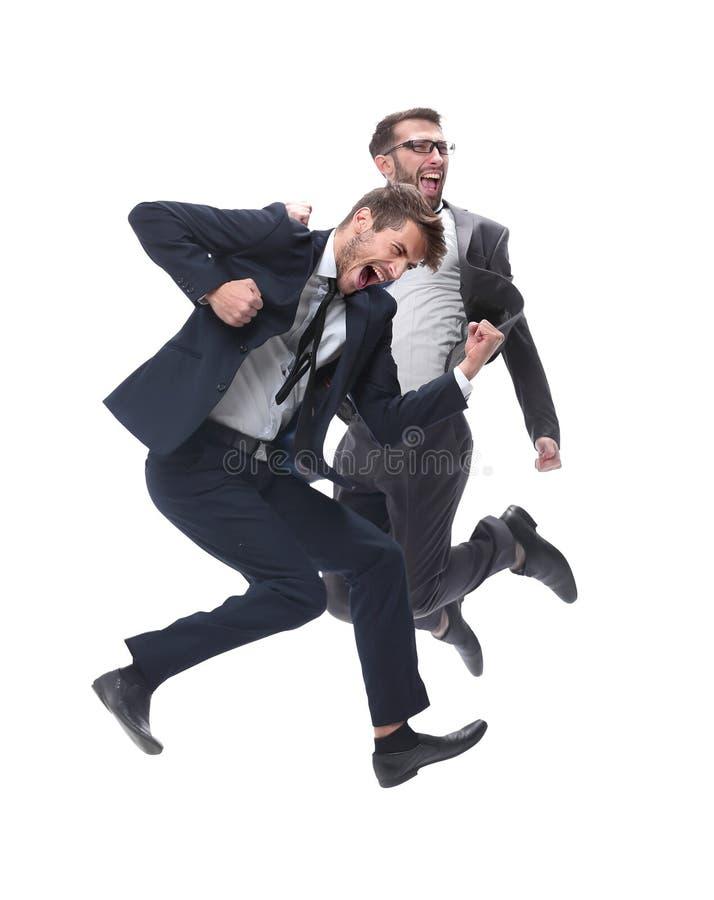 Nella piena crescita due genti di affari ballanti allegre immagini stock