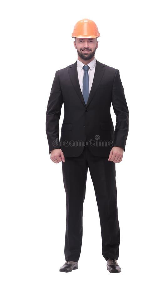 Nella piena crescita riuscito uomo d'affari in un casco protettivo immagini stock libere da diritti