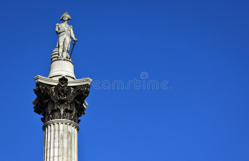 Nelson's Column, Trafalgar Square. Nelson's Column rises to nearly 185 feet in the centre of Trafalgar Square and was erected to celebrate his stock photography
