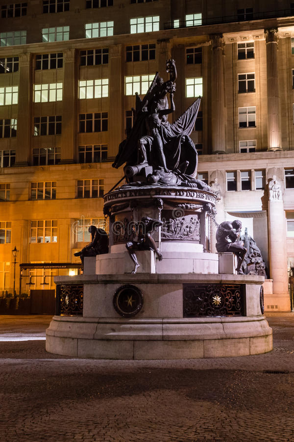 Nelson Monument by night. ENGLAND, LIVERPOOL - 15 NOV 2015: Nelson Monument by night. The Nelson Monument is a monument to Admiral Horatio Nelson, in Exchange stock photos