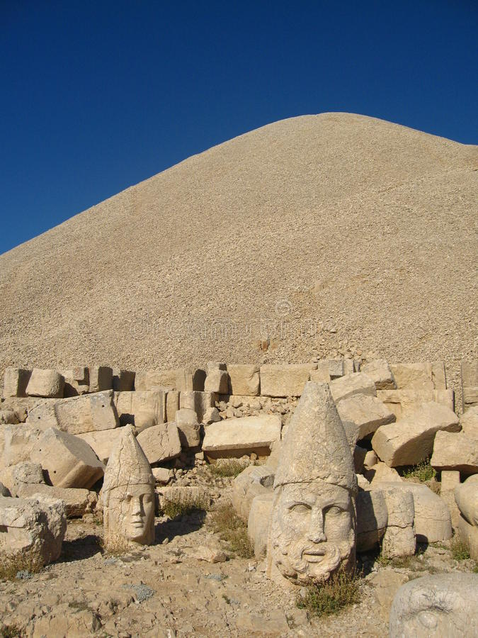 Nemrut Dagı Milli Parki, Mount Nemrut with ancient statues heads og the king anf Gods. NemrutorNemrud Turkish:Nemrut Dag high mountain in royalty free stock photos