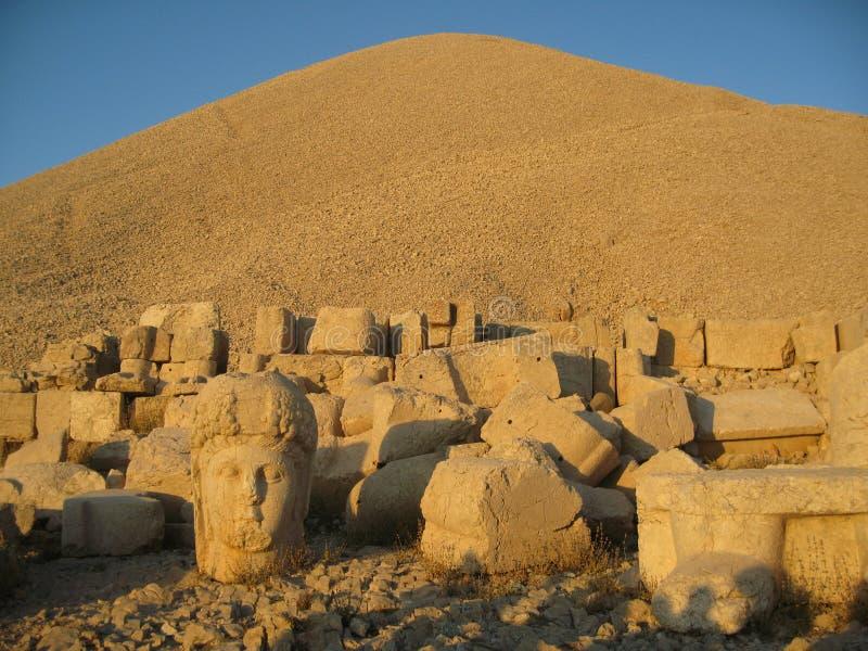 Nemrut Dagı Milli Parki, Mount Nemrut with ancient statues heads og the king anf Gods. NemrutorNemrud Turkish:Nemrut Dag high mountain in stock photo