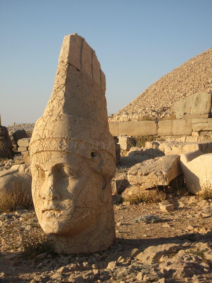 Nemrut Dagı Milli Parki, Mount Nemrut with ancient statues heads og the king anf Gods. NemrutorNemrud Turkish:Nemrut Dag high mountain in royalty free stock image