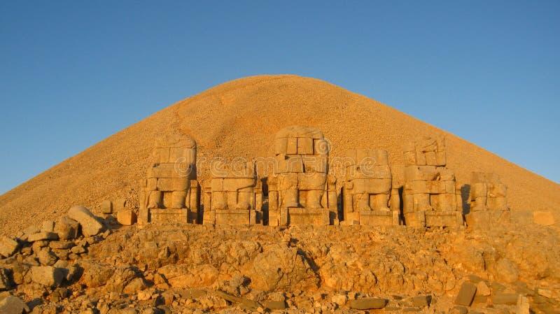 Nemrut Dagı Milli Parki, Mount Nemrut with ancient statues heads og the king anf Gods. NemrutorNemrud Turkish:Nemrut Dag high mountain in royalty free stock photo