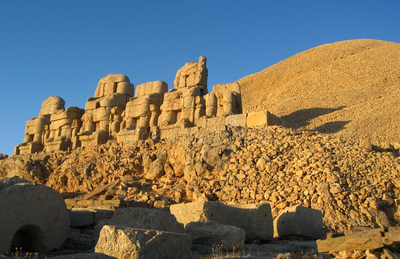 Nemrut Dagı Milli Parki, Mount Nemrut with ancient statues heads og the king anf Gods. NemrutorNemrud Turkish:Nemrut Dag high mountain in royalty free stock images