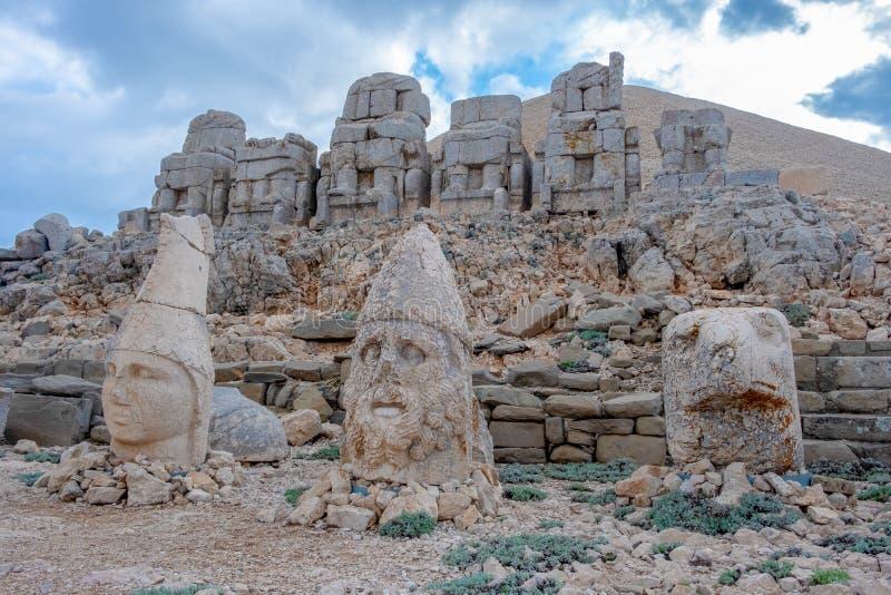 Nemrut Dagi, Anatolia, Turkey.the god Apollo. Nemrut Dagi, Anatolia, Turkey top the god Apollo and ancient stone statues of the Goddess Tyche of Commagene ruins royalty free stock photography