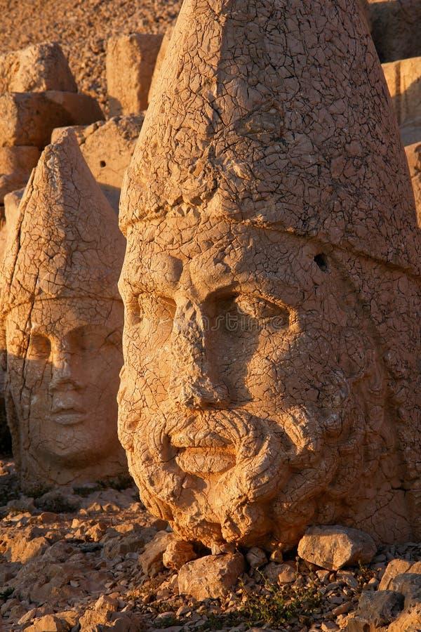 Nemrut - Turkey - Heads of statues on Mount Nemrut. Heads of the colossal statues on Mount Nemrut in Turkey royalty free stock images
