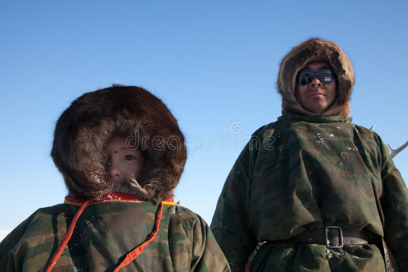 Download The Nenets man nad his son editorial image. Image of snow - 24941080