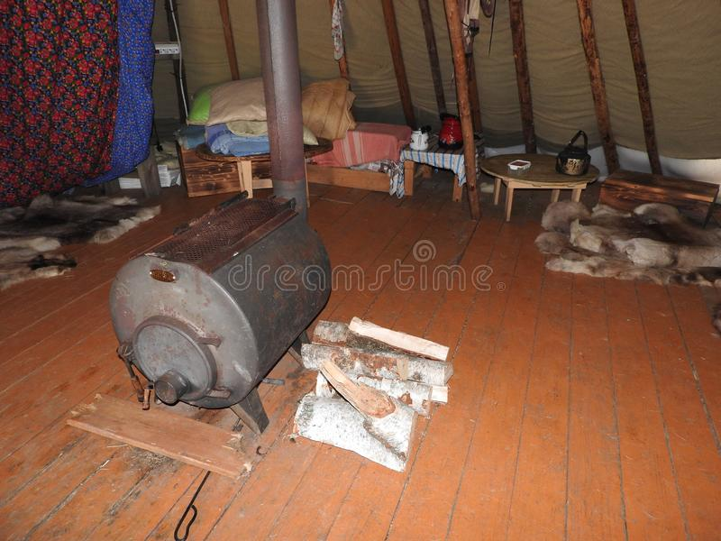 Nenets plague house, built with a large number of poles in the center of the shaft, the interior of the plague, decoration.  stock image
