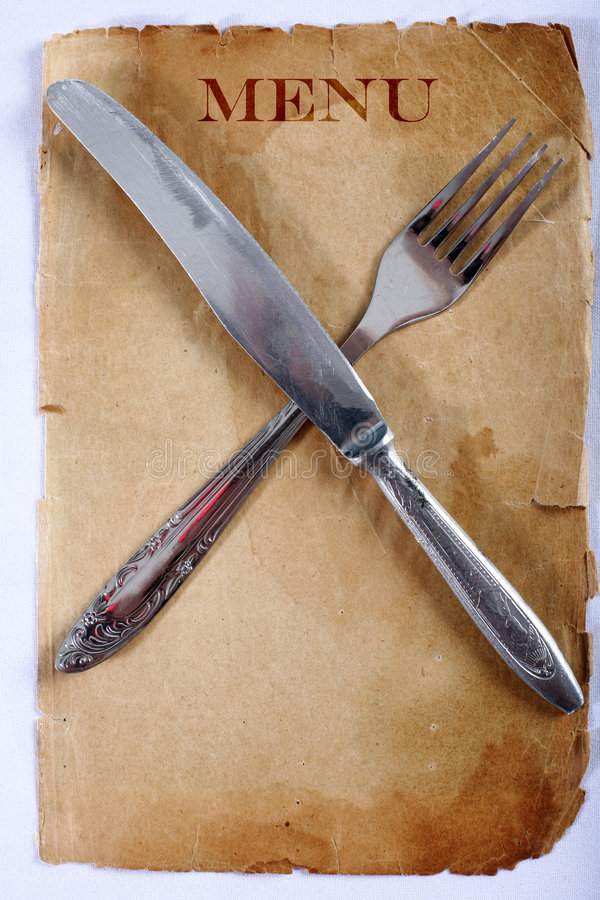 Nenu de cru avec le couteau et la fourchette photographie stock libre de droits