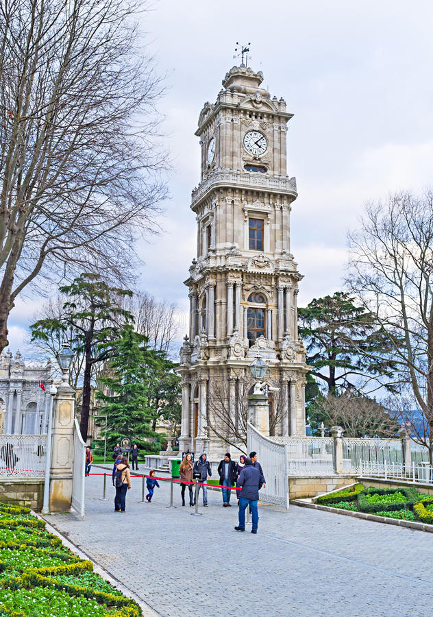 The neo-baroque tower. ISTANBUL, TURKEY - JANUARY 13, 2015: The beautiful ottoman neo-baroque clock tower of Dolmabahce Palace, on January 13 in Istanbul stock photography