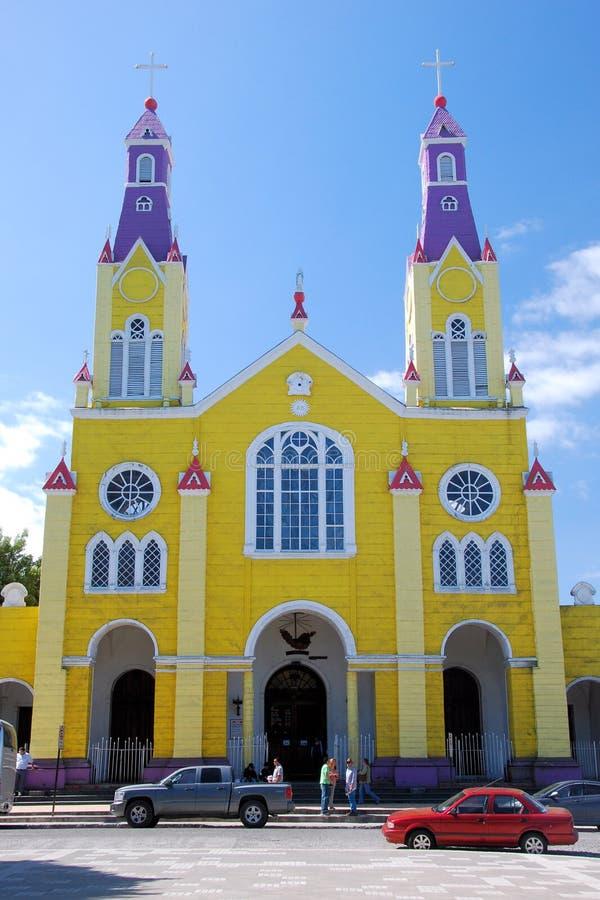 Neo-Gothic Catholic Church of San Francisco - Chiloé island - Chile. Catholic Church of San Francisco - Iglesia de San Francisco – Bright yellow and stock photos