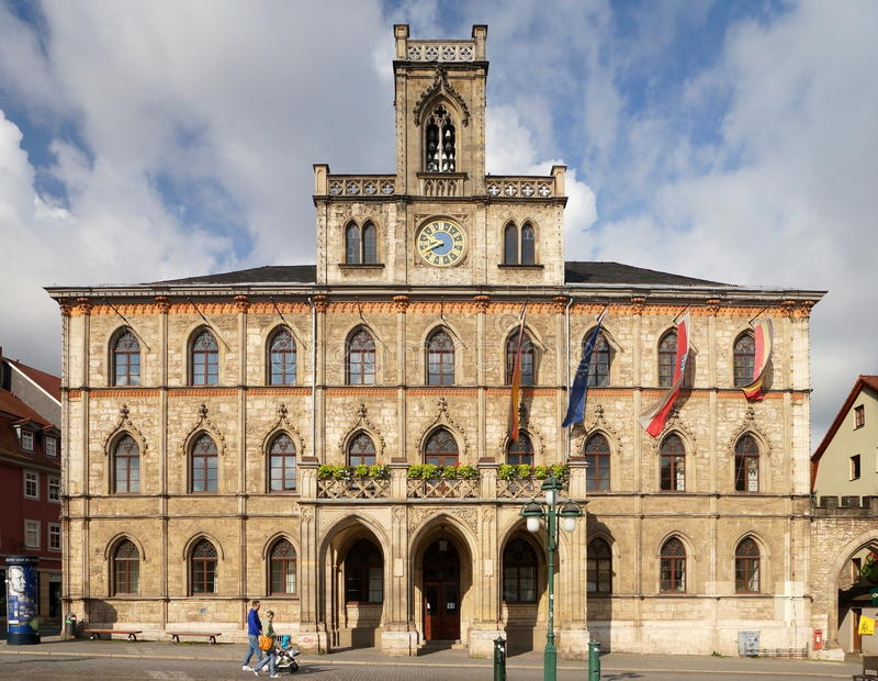 Neo-Gothic Town Hall of Weimar. The Neo-Gothic town hall of Weimar was re-built in 1841 after destruction by fire. The city of Weimar in the federal state of stock photography