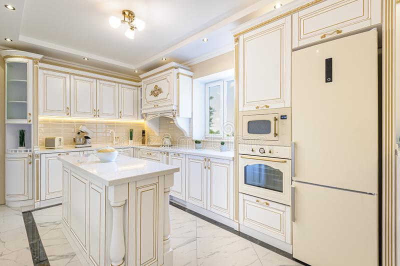 Neoclassic style luxury kitchen interior with island stock photography