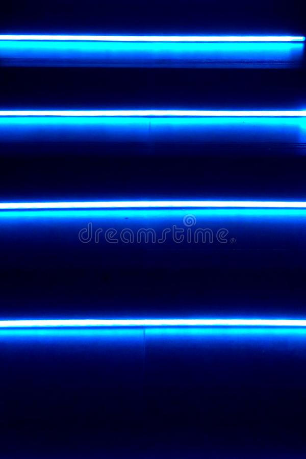 Neon background. Blue stripes royalty free stock images
