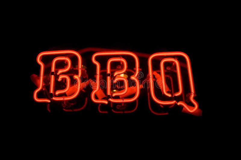 Neon BBQ Sign. A red neon BBQ sign on a black background royalty free stock image