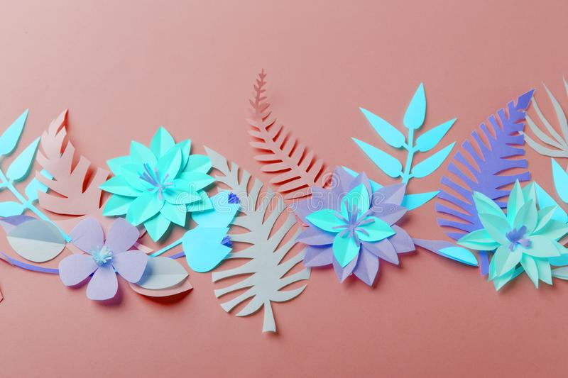Neon color colorful flower composition - handmade papercraft flowers and leaves on pastel background, spring, summer, easter, royalty free stock photo