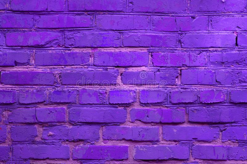 Neon colored brick wall background. Horizontal toned backdrop. Neon ultra violet colored brick wall background. Horizontal toned backdrop stock photos