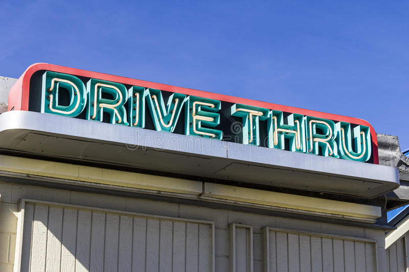 Neon Drive Thru Sign at a Fast Food Restaurant I stock images