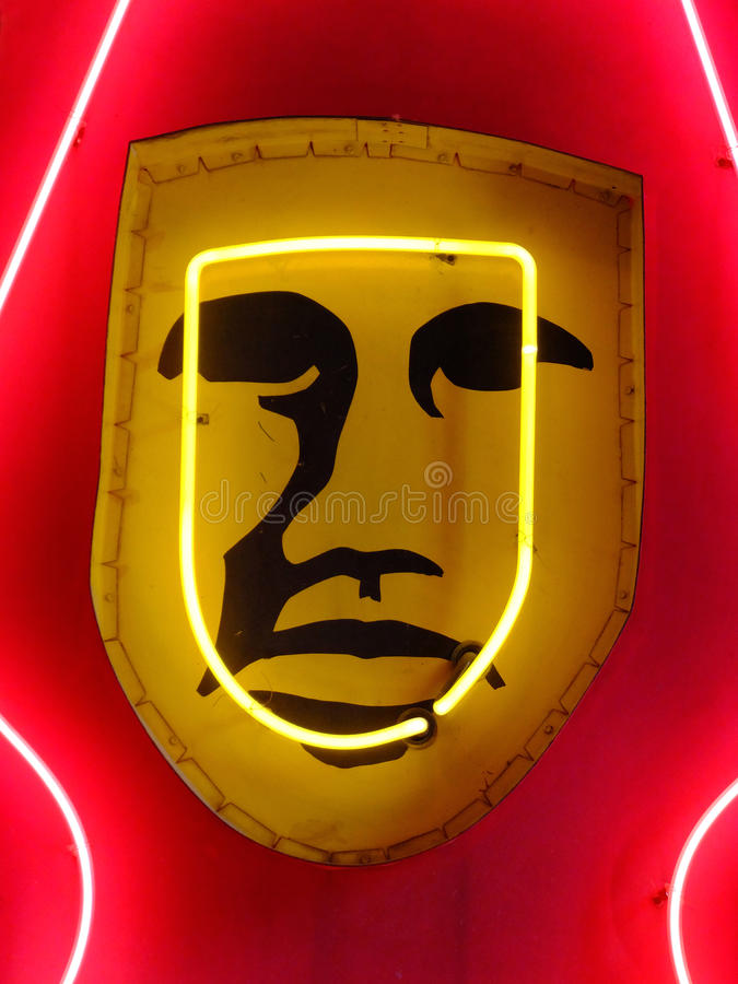 Neon Face. Strange vintage signage with neon light highlighting facial imagery stock photo