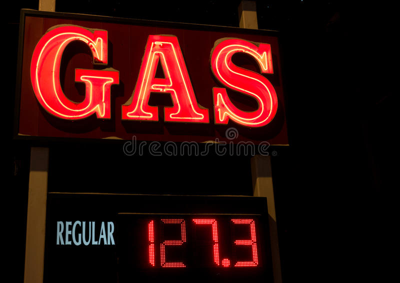 Neon Gas Sign. A neon fuel sign at a gas station with led price sign royalty free stock photography