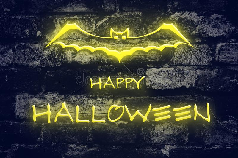 Neon inscription Happy Halloween on the background of an old brick wall. Holidays. Neon inscription Happy Halloween on the background of an old brick wall royalty free stock photography