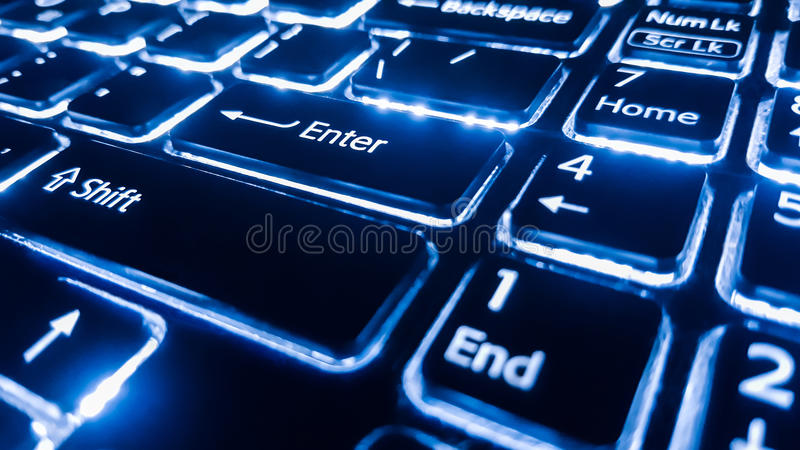 Neon keyboard with enter button. Focus on the . Neon keyboard with enter button. Focus on the enter button royalty free stock images