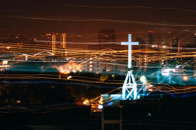 Neon light cross sign from church with light trail.  royalty free stock photos