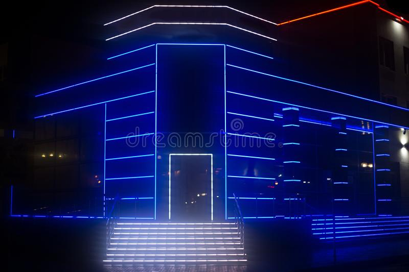 Neon light decorating a mordon building royalty free stock image