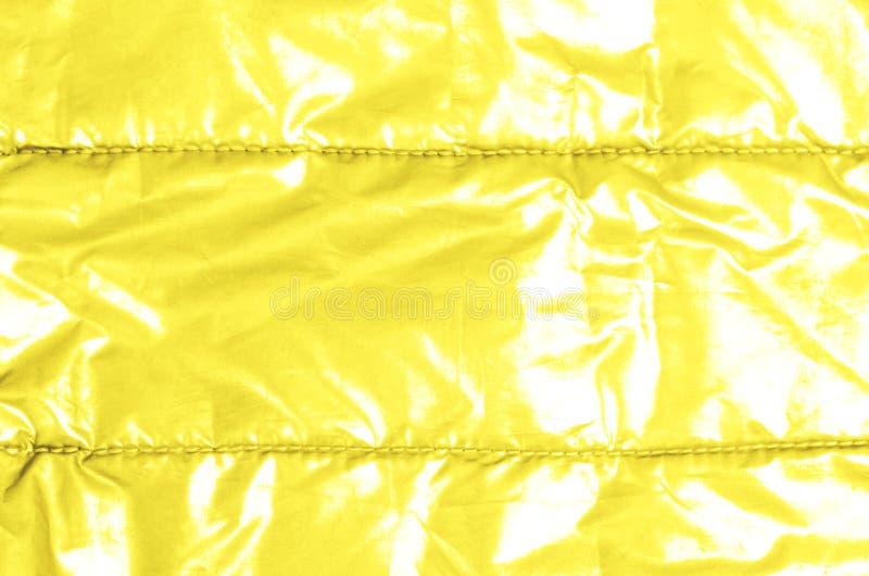 Neon light yellow background with metallic shine royalty free stock photography