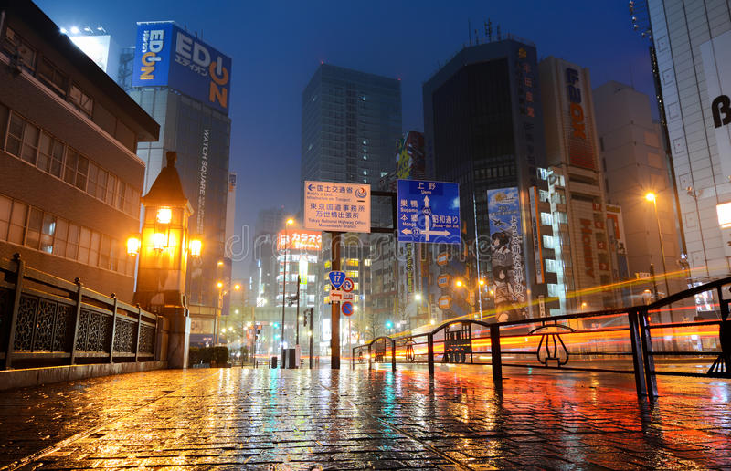 Neon lights of Akihabara, Tokyo`s famous electronics shopping district, glittering on a rainy night. Tokyo, Japan - April 8, 2017 - Street and traffic lights stock photos