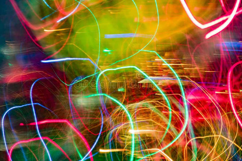 Neon multicolor glowing lines. Defocused gleam in motion.  royalty free stock images