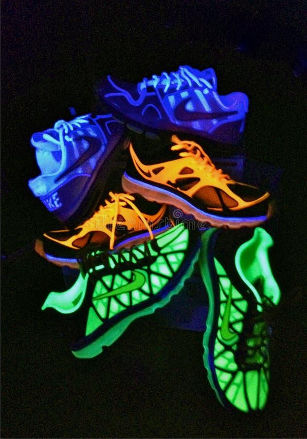 Neon Nike Shoes royaltyfri bild