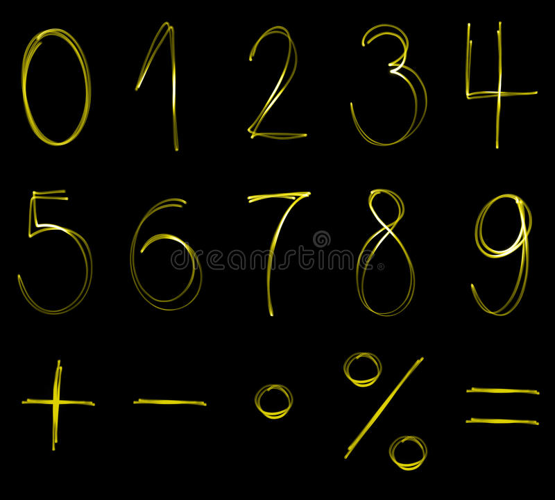 Neon numbers. Flourescent numbers and math symbols in yellow neon color royalty free stock photography