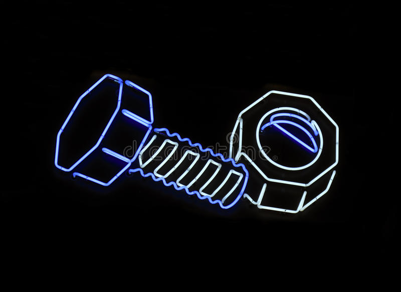 Neon nut and bolt shaped sign. Neon sign shaped like a nut and bolt royalty free stock photos