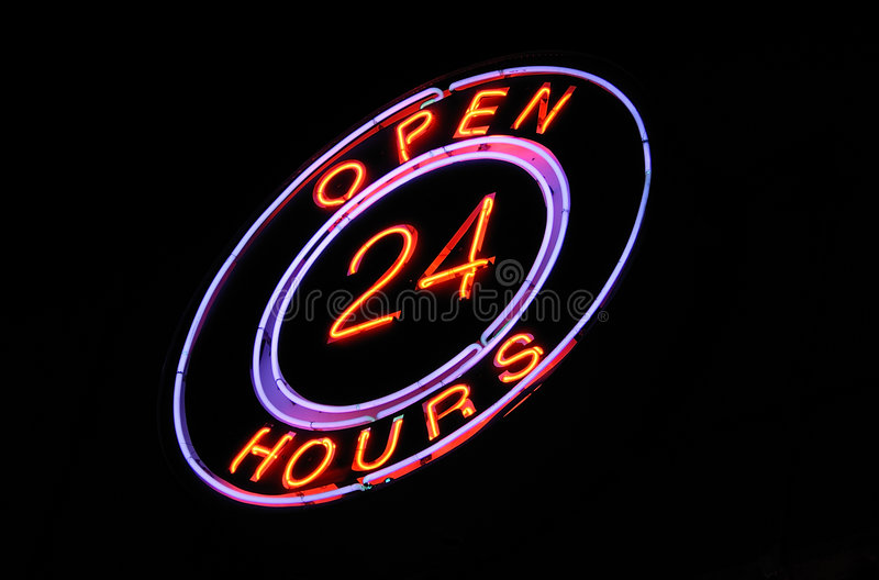 Neon 'Open 24 hours' sign stock photography