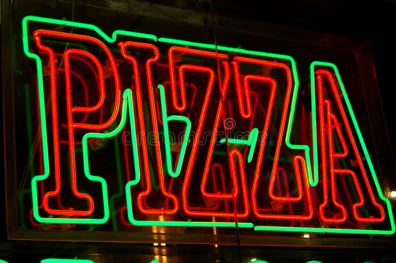Neon pizza sign stock photo