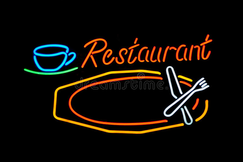 Neon restaurant. Neon sign in a restaurant window advertising breakfast, lunch, dinner, and weekend brunch royalty free stock photos
