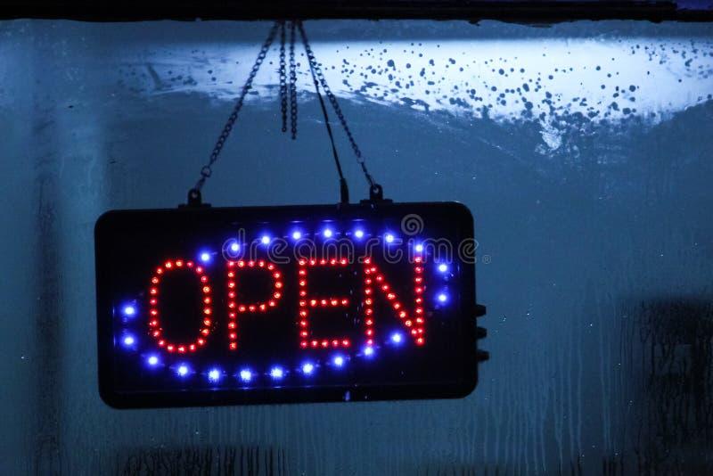 Neon sign Open on window shop. stock photo