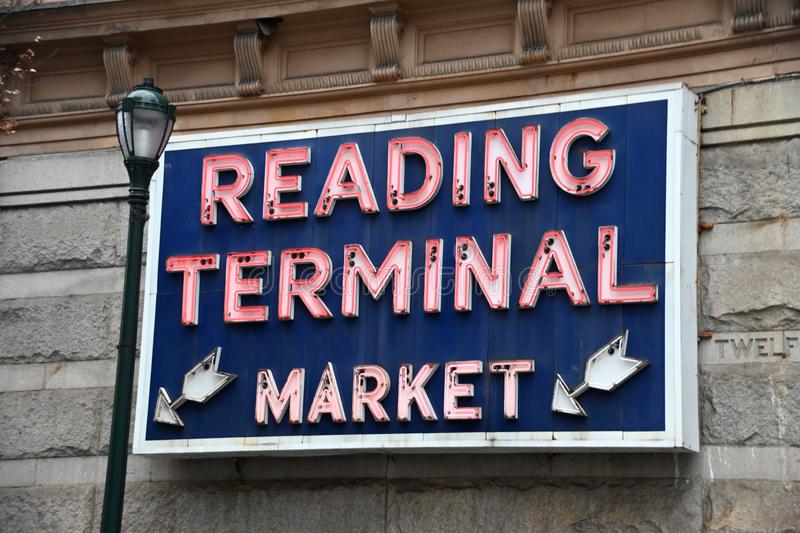 Reading Terminal Market Neon. A neon sign pointing to an entrance to the Reading Terminal Market in Philadelphia Pennsylvania. The old railroad station has royalty free stock photography