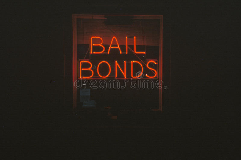 A neon sign that reads �Bail Bonds� stock images