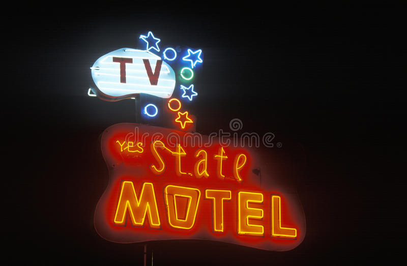 A neon sign that reads �State Motel� royalty free stock image