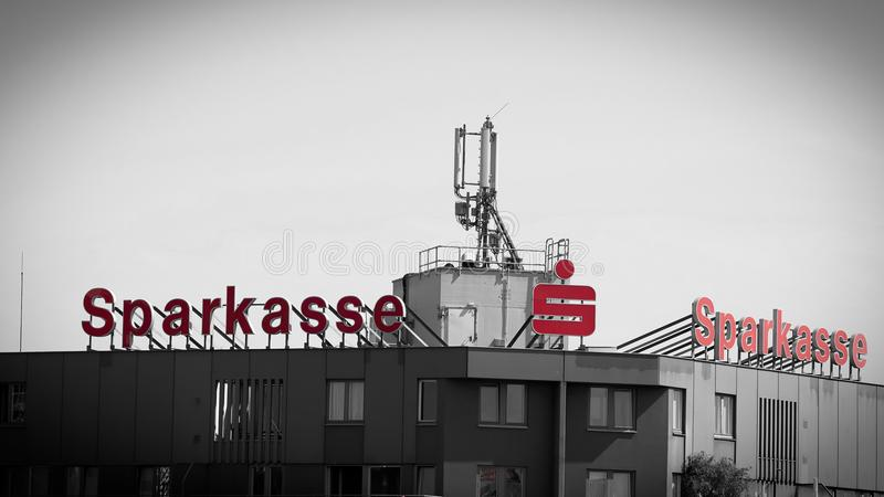 neon sign on the roof of the bank Sparkasse royalty free stock images