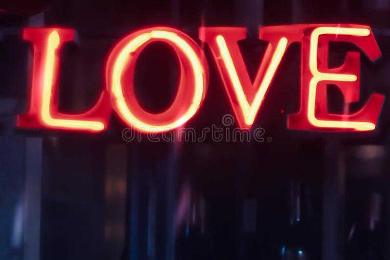 Neon sign, the word Love  on dark background. Design element for Happy Valentine`s Day. Ready for your design, greeting card, stock image